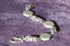Glass bead with byzantine weave