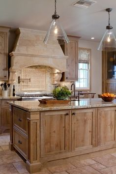 French country kitchen bleached wood cabinets, masonary range hood.  French Colonial style in Pasadena. Charmean Neithart Interiors.