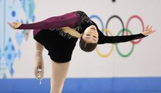 Yuna Kim of South Korea competes in the women's free skate figure skating finals at the Iceberg Skating Palace during the 2014 Winter Olympics, Thursday, Feb. 20, 2014, in Sochi, Russia. (AP Photo/Bernat Armangue)