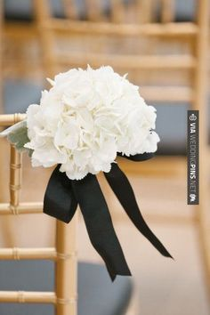 Black ribbon contrasting with white flowers
