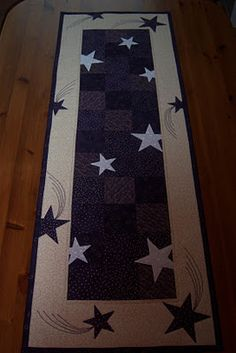 Advent runner - Difficult to see purple colors, but they are dark and have printed dots, stars, flowers and hearts in gold.