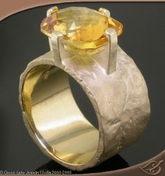 gorgeous ring...yellow sapphire probably way out of my price range I can't tell but it's beautiful