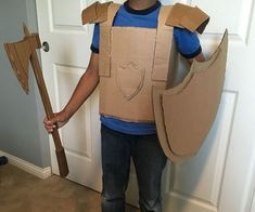 This half-made suit of armor is ready to do anything from saving a damsel in distress to pillaging a neighboring village. This suit is made of four parts:. Cardboard Costume, Cardboard Crafts, Recycled Costumes, Diy Costumes, Armor Of God, Suit Of Armor, Diy Knight Costume, Roman Soldiers, Sunday School Crafts