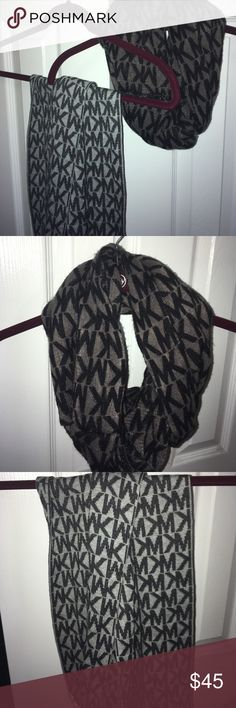 Michael Kors Scarves ALL OFFERS CONSIDERED-- TWO Authentic Michael Kors scarves! The light grey scarf is a long scarf, the dark grey scarf is an infinity scarf. Tags are off but they have never been worn! Michael Kors Accessories Scarves & Wraps