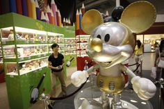 A giant rendition of Mickey Mouse stands with arms outstretched at the 'Mickey Mouse Through The Years' exhibition inside the Mid Valley Megamall in Kuala Lumpur, Malaysia, on July 5, 2012. A total of 350 interpretations of Mickey Mouse designed by people from all walks of life including celebrities, students, artists, and corporate sponsors are on display in the third floor gallery area of the mall from June 11 to September 17, 2012.