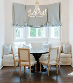Design Loves Detail found on Ave Home - round dining tables with banquette and Louis XVI style chairs - Roman Shades Dining Nook, Round Dining Table, Dining Room Table, Banquette Dining, Roman Shades Kitchen, Raw Furniture, Bay Window Treatments, Elegant Dining Room, Dining Room Inspiration