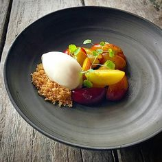 Poached Swedish plum flavored with vanilla and meadowsweet. Served with crumble and vanilla ice cream. Ceramic plate by @vastergarden .