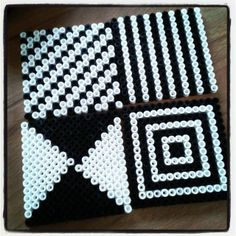 Coasters black&white hama beads by Catou also a GR8 visual to mount on the wall next to the baby's changing table!