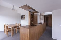 The dark, top floor-unit of an old Bucharest apartment building was renovated by architect Andreas Heierle. By opening up the floor plan with big windows and a multi-purpose kitchen island, he brought a comfortablespaciousness to the 645-square-footdwelling. Courtesy of Andrei Margulescu. This originally appeared in Minimal Romanian Attic Renovation Complete with an Epic Bathtub.