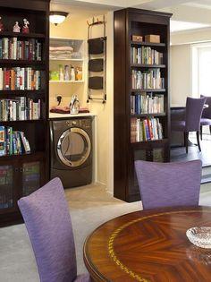 Storage & Hidden Door. great idea for the laundry room open doorway with the wall of book shelving