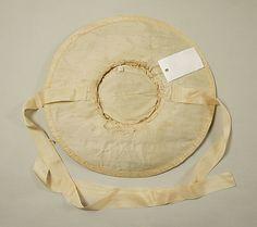 Hat Underside Date:     ca. 1760 Culture:     British Medium:     raffia, silk Dimensions:     Diameter: 14 1/4 in. (36.2 cm) Credit Line:     Purchase, Irene Lewisohn Trust Gift, 1984