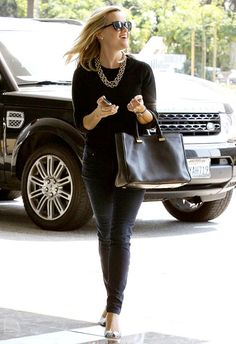 A svelter-than-ever Reese Witherspoon rocked a heavy gold necklace heading into a Santa Monica office.