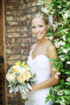 Beautiful bride with muted yellow and ivory rose bouquet  Venue - Sassi  Photographer - Terry McKaig #youreventflorist #yellowbouquet
