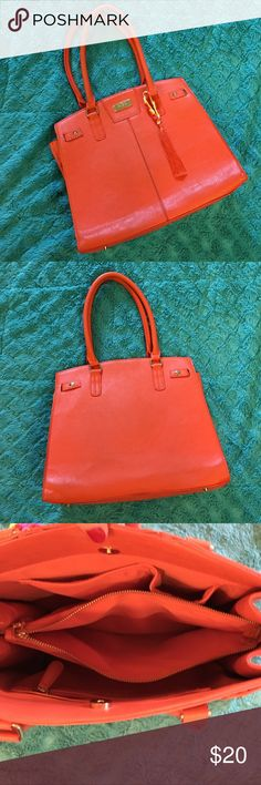 BCBG Paris purse good condition Beautiful happy orange color BCBG Paris purse with four pockets ,button snap top, comfortable and fun purse ! Has handmade tassel purse charm added to it is removable if want to. Light wear on the bottom side of purse. Otherwise great for spring very pretty! 📬Same day next day shipping📬 bundle get 10% off🎀. Free gift with purchase😊 BCBG Paris  Bags Shoulder Bags