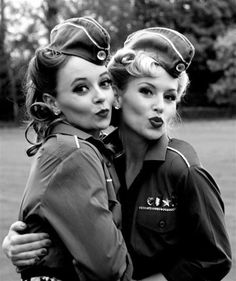 """CAVEAT: Though widely repinned here and otherwise disseminated on the Internet as a World War II photograph, usually captioned """"When duck face was cute"""", this is simply a black-and white version of a present-day, modern color picture of two women dressed up in faux uniforms of that era. On close examination, the photography is digital, and the fabrics, make-up, sequins, and insignia are all incorrect for the alleged period. The picture first appeared around 2010."""