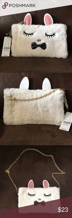 Bunny charging crossbody purse NWT Super cute bunny 🐰 charging crossbody clutch purse. This purse has a built in charger that works with both iPhone and android phones. I tried it with my iPhone and it does work. Awesome for a quick charge on the go! New York & Company Bags Crossbody Bags