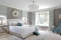 Transitional Master Bedroom with Chandelier, Carpet, Crown molding, High ceiling