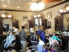 "Right when you walk into Magic Kingdom and just to the left, there is a place to get your hair cut called Harmony Barber Shop. This is an old-fashioned kind of place where you can get a quick trim or a full groom.  If your child doesn't need a haircut they can still have the old-fashioned barber shop experience by having their hair adorned with clear gel and colorful ""pixie dust"".-Harmony Barbershop at Magic Kingdom"