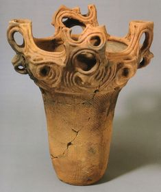 Women's Japanese Prehistoric Jōmon Pottery. All Jomon pots were made by hand, the potter building up the vessel from the bottom with coil upon coil of soft clay. The clay was mixed with a variety of adhesive materials, including mica, lead, fibers, and crushed shells. After the vessel was formed, tools were employed to smooth both the outer and interior surfaces. When completely dry, it was fired in an outdoor bonfire at a temperature of no more than about 900° C.