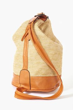 """This vegan woven backpack screams, """"take me  to Hawaii, you won't look like a tourist!"""""""