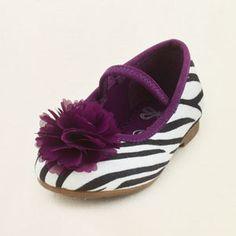zebra ballet flat...Emily got her something similar to hese already for her baby shower...how sweet! :)