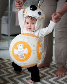 I made a BB-8 halloween costume out of styrofoam for my daughter, *literally* one-handed after breaking my elbow. She FREAKS out when we try to put it on her. Here's a couple shots between the screams. Oh well, better luck next year:)