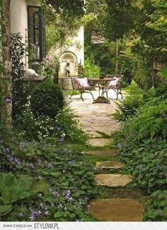 outdoor setting alfresco stone lime Italian wrought iron foliage