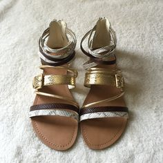 •Gladiator Sandals• Add this flat gladiator sandal to your wardrobe,it features a faux leather upper/snake skin detail/flat rubber outsole/back heel zipper/new in box/thanks for looking Promise Shoes