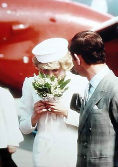 Princess Diana lost in the fragrant Lily-o-Valley bouquet and Charles impatiently waiting, lol.