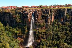 Superbly situated just 50 metres from the Graskop Gorge Falls with a magnificent view over the Mpumalanga Lowveld. An ideal location for guests to enjoy the abundant natural beauty. Here you can go on forest walks, berg hikes or pay a visit to our rain forest. Mogodi Lodge offers ten self-catering, two-bedroom flats, which are fully furnished and equipped. Click on pic to see more. Self Catering Cottages, Bungee Jumping, South Africa, Natural Beauty, Waterfall, Places, Nature, Photography, Outdoor