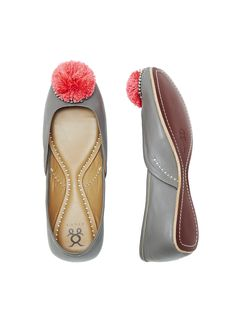These grey leather flats get a playful update with a contrasting hot pink pom-pom atop silver beading. These pom pom flats run large. We recommend selecting one size down.