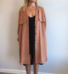 A-line trench coat in a peachy beige. Made of 100% Tencel. Made in China by Just…