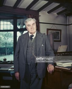 English composer and conductor, Ralph Vaughan Williams (1872-1958) pictured standing beside a piano at home in Surrey, England in January 1949.