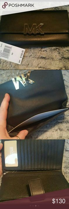 💟SALE💟NWT! MK Large Leather Wallet Brand new with tags! 100% AUTHENTIC! 12 CC slots including one see thru for ID. Multiple slip compartments for bills, coupons, etc. Front under gold plated MK emblem has a slip compartment. Other side is snap button closure. Sorry, no trades! REASONABLE OFFERS WELCOME! Please use the offer button below. No negotiating through comments please. Michael Kors Bags Wallets