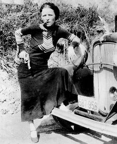 Bonnie Elizabeth Parker (October 1, 1910 - May 23, 1934) of 'Bonnie and Clyde'. Posing with a Ford V-8 B-400 convertible sedan, 1932. S)