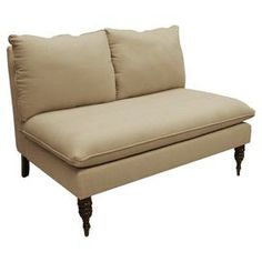 "Linen-upholstered settee. Handmade in the USA with solid pine wood.Product: Settee  Construction Material:  Linen and wood  Color: SandstoneFeatures: Comfortable and plush foam padding  Turned legsHandmade in the USA     Dimensions: 35"" H x 49"" W x 35"" D    Note: Assembly required"