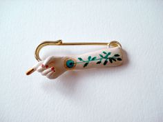 arm brooch by irana, via Flickr