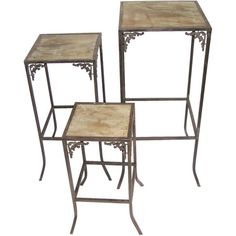 Set of three plant stands with scrolling metal frames and wood tops.         Product:  Small, medium and large stand    ...