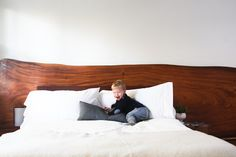 ikea bed frame + slab of hardwood for a headboard #diy #bed