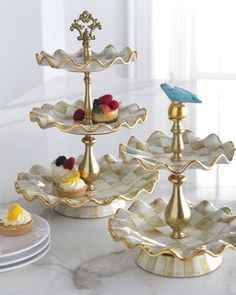 Parchment Check Tiered Stands by MacKenzie-Childs at Horchow.