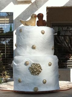 "Custom cake, ""lace"" was created from a mold of the lace on the bride's dress. By Adair Weddings"