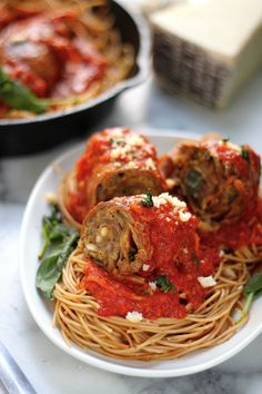 Sicilian Braciole - Rich, tender braciole is slow cooked in marinara sauce and served over spaghetti! A Sunday dinner classic!