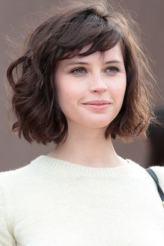 bob haircut with bangs - This look makes the case for long bobs and bangs on thick, wavy hair. Read more: http://www.dailymakeover.com/trends/hair/fall-haircuts-2014/#ixzz3E0hywvkt