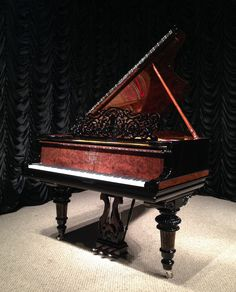 The finish is done in high-polish black lacquer which is accented by exotic burl wood trim on the legs, lyre, music rack, and inside rim. The lid prop and underside of the lid is also finished in beautiful exotic burl wood. The level of restoration this piano has received is the finest possible quality. Every last detail of this piano looks, plays, and sounds like a new instrument. A matching bench is included. Steinway pianos of this style and caliber are among the most rare and des...