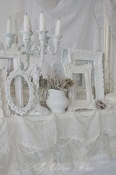 Simply vintage; place frames flat on table (w/o glass) to 'frame' centerpiece