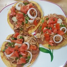 Shredded chicken, ff refried beans, cheese, onion, and tomato tostadas is whats for dinner!  10pp #ww