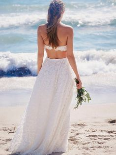 Lola Set | Get swept away by your soul mate in the perfect lace maxi set for the bride who will always share her heart with the sea. Anything but traditional, this strapless twist on a bustier features a built-in tube silhouette, with molded cups for a beautiful fit, and hook-and-eye closures in back. Intricately embroidered sheer tulle overlay creates an illusory effect, perfect against a misty backdrop or cerulean scape. A pointed hem falls delicately over the waist. Matching skirt with…