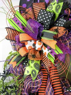 Let the Halloween madness begin with this bold and beautiful witchy wreath. An extra large designer quality plaid deco mesh base with two 36 gathering bows and two multi-patterned Terri Bows with nin Halloween Mesh Wreaths, Halloween Trees, Deco Mesh Wreaths, Holidays Halloween, Holiday Wreaths, Halloween Crafts, Halloween Decorations, Halloween Garland, Autumn Wreaths