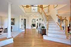 The Two Story Entrance Hall Displays Tuscan Columns That Frame Living Room