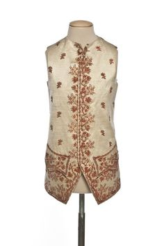 Waistcoat, France, 1775-1780. Cream silk embroidered with floral motifs and floral sprays in red.